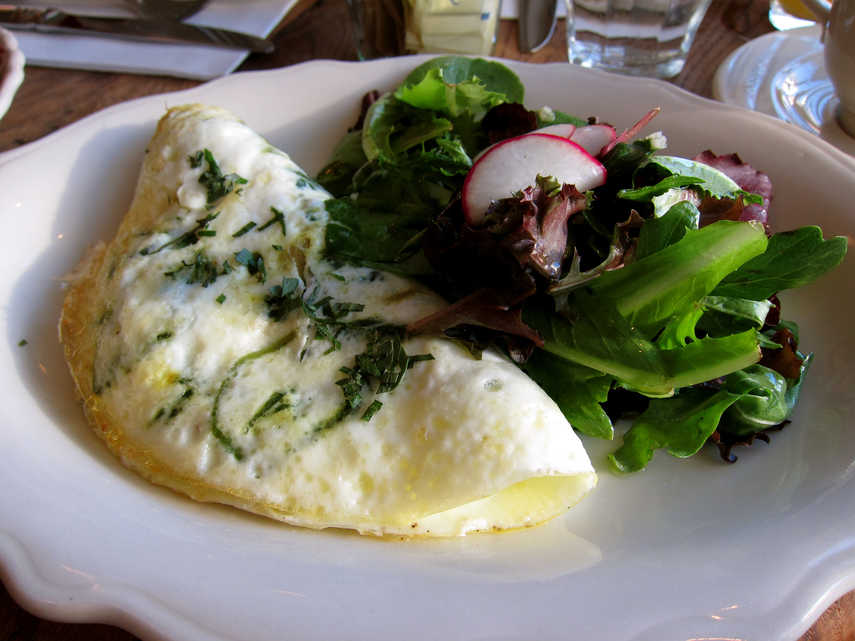 , 'spa eggs'..egg white omelet, sautéed spinach, and goat cheese ...